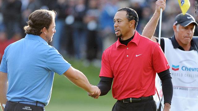 Tiger Woods, right, congratulates Chevron World Challenge winner Graeme McDowell after Sunday's playoff.