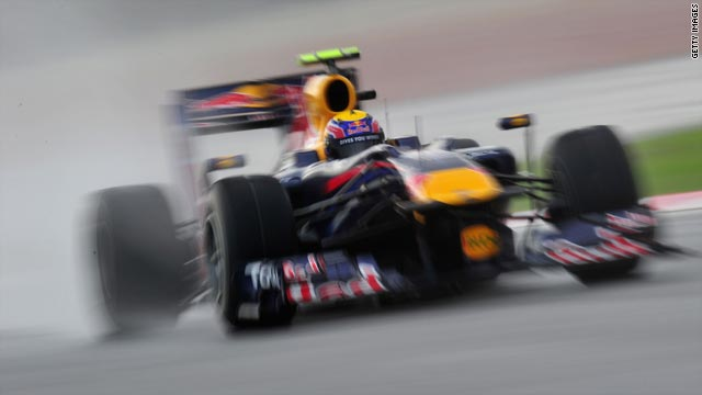 Mark Webber earned the second pole position of his F1 career in treacherous conditions in Malaysia.