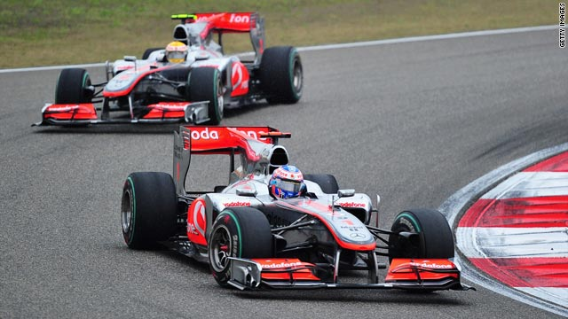 Jenson Button headed off McLaren teammate Lewis Hamilton to win the Chinese Grand Prix in Shanghai on Sunday.