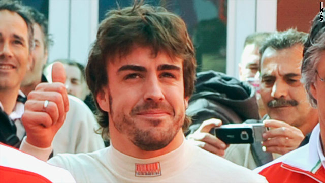 Alonso gives the thumbs up at early season testing in Jerez for his new team Ferrari.