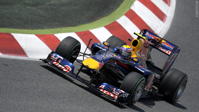 Mark Webber drives his super-quick Red Bull to the front of the grid in Spain.