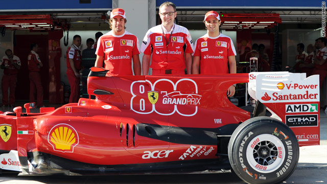 Ferrari drivers Fernando Alonso, left, and Felipe Massa, right, flank team principal Stefano Domenicali on Thursday.