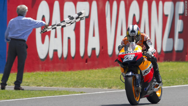 Dani Pedrosa takes the checkered flag in Italy after leading from start to finish at Mugello.