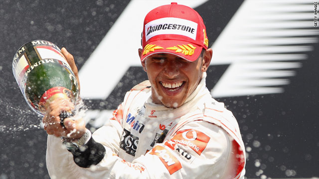 Lewis Hamiton pops open the champagne after his second straight victory in the 2010 world championship.