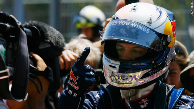 Germany's Sebastian Vettel celebrates his pole position for Sunday's European Grand Prix in Valencia.