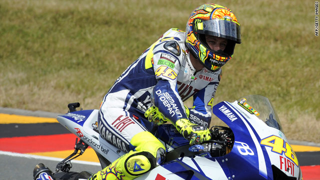 Valentino Rossi cruises around after finishing fourth in his comeback race in Germany.