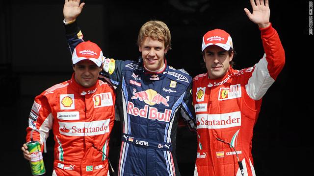 German Grand Prix winner Fernando Alonso, right, with Sebastian Vettel, center, and second-placed Felipe Massa.