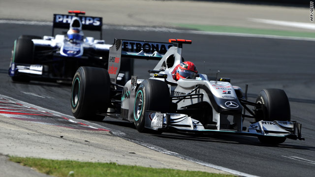 Michael Schumacher defends his position against Rubens Barrichello during the Hungarian Grand Prix.