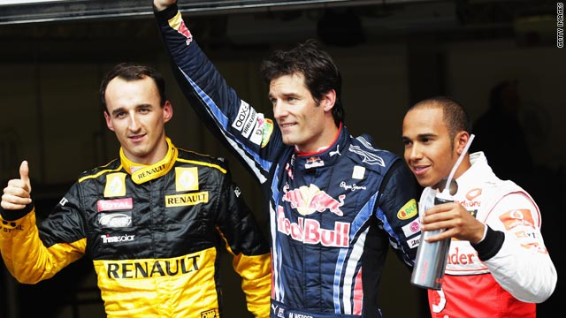 Mark Webber celebrates securing pole for Sunday's Belgian GP. Lewis Hamilton will start in second place; Robert Kubica third.