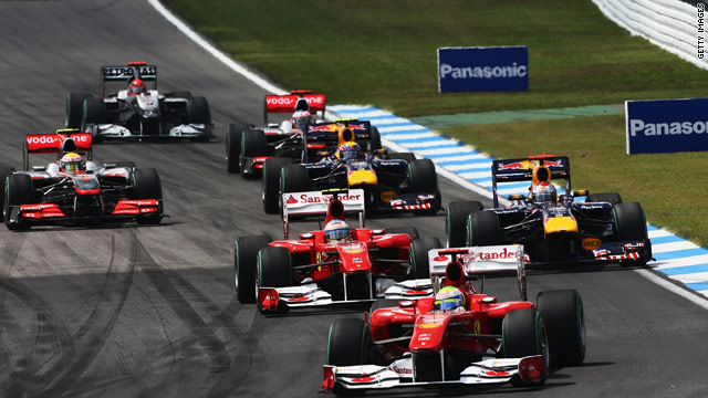 Felipe Massa is ahead of Fernando Alonso during the early stages of the German Grand Prix.