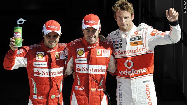 Ferrari's Fernando Alonso (center) claimed pole for the Italian Grand prix . Jenson Button (right) was second fastest, while Felipe Massa was third.