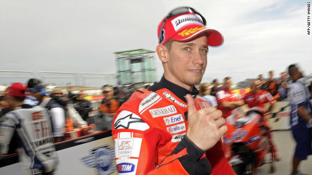 Australia's Casey Stoner shows his approval after qualifying in first place for Sunday's MotoGP race in Aragon, Spain.