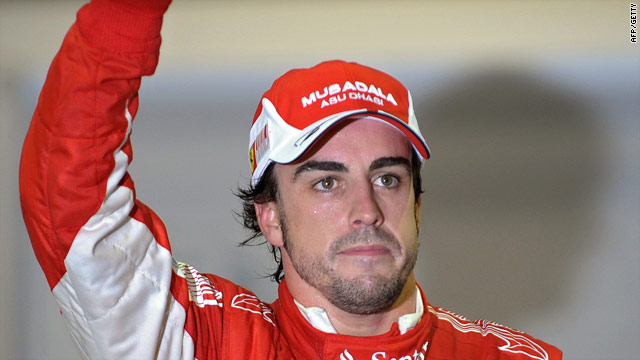 Fernando Alonso celebrates his pole position in Singapore ahead of Red Bull's Sebastian Vettel.