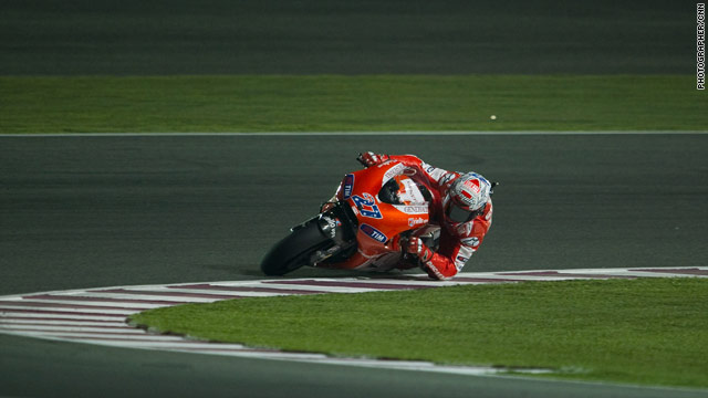 Former world champion Casey Stoner is on pole position for the final MotoGP of the season in Valencia.