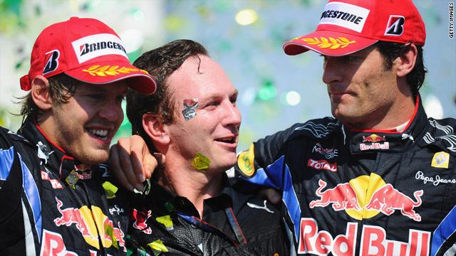 Red Bull team principal Christian Horner is flanked by Sebastian Vettel (L) and Mark Webber aftter the Brazilian Grand Prix.