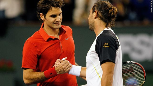Baghdatis (right) saved three match points before turning the match around against world number one Federer.