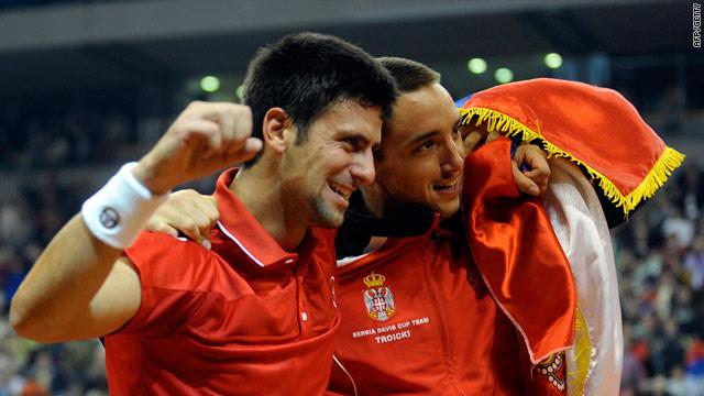 Djokovic (left) and Viktor Troicki celebrate Serbia's passage to the quarterfinals.