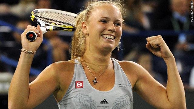 Caroline Wozniacki celebrates after defeating her friend Agnieszka Radwanska in the semifinals.