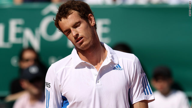 Andy Murray cuts a dejected figure after his straight sets defeat in the second round in Monte Carlo.