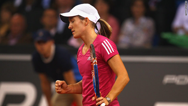 Henin swept to victory with a superb display in the deciding set in Stuttgart.