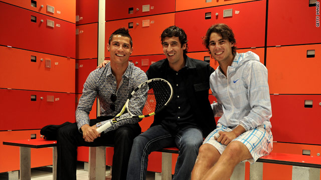 Cristiano Ronaldo and Raul pay a visit to Rafael Nadal in the locker room at the Madrid Masters.