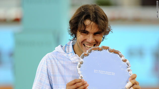 Rafael Nadal in familiar pose after defeating Roger Federer to remain unbeaten on his favored clay-courts this season.