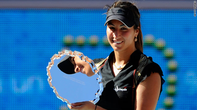 Rezai proudly displays her trophy after stunning Venus Williams in the final of the Madrid Open.