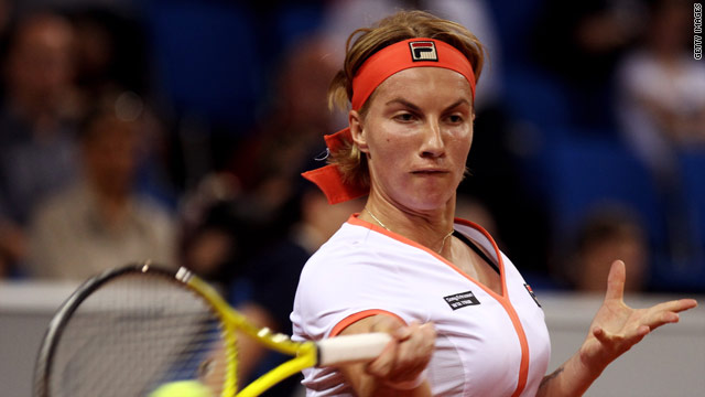 Svetlana Kuznetsova is safely through as she starts the defence of her French Open title.