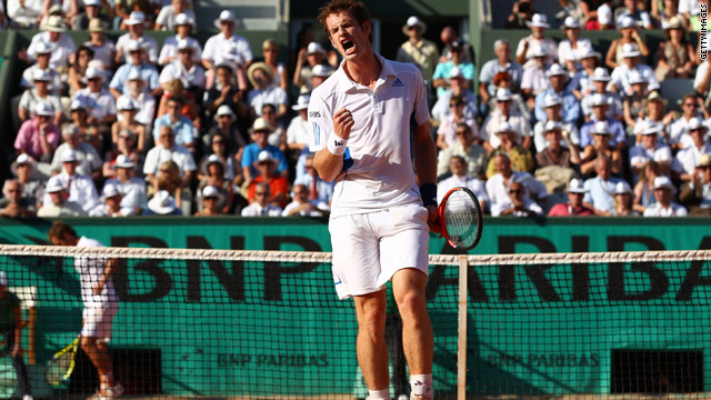 Andy Murray celebrates winning a point on his way to a stunning five-set victory over Richard Gasquet.