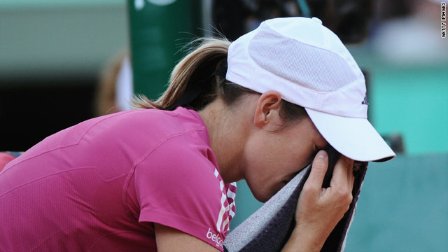 Henin looks dejected during her last 16 battle with Samantha Stosur in Paris.