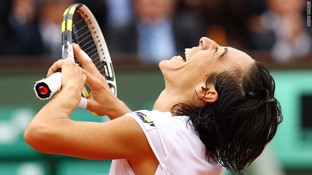 Francesca Schiavone celebrates after booking her place in the French Open semifinals.