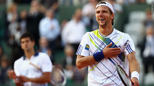 Jurgen Melzer salutes the crowd in Paris after beating Novak Djokovic to reach his first Grand Slam semifinal.