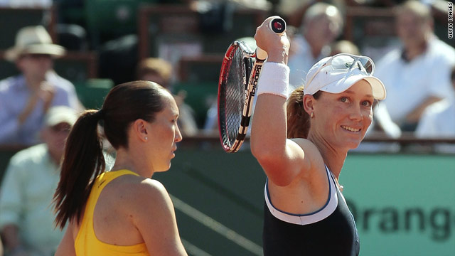 Samantha Stosur smiles at the crowd after securing her place in the French Open final.
