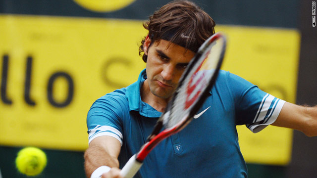 Roger Federer is the picture of concentration as he plays a  backhand during his semifinal win in Halle.