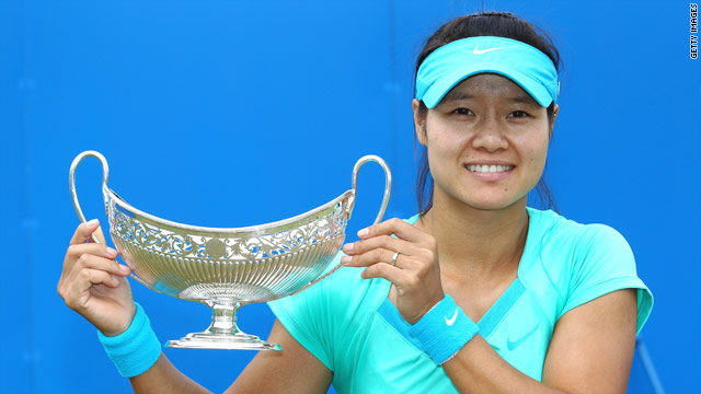 Li Na of China holds aloft the Aegon Classic trophy after her victory over Maria Sharapova