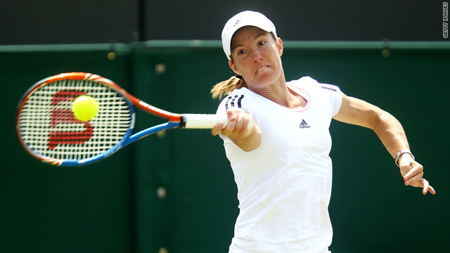 Henin powers a forehand during her straight sets victory at Wimbledon on Wednesday.