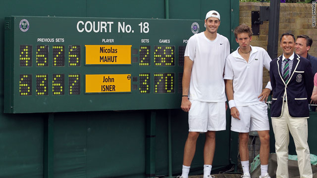 American player John Isner and French opponent Nicolas Mahut at the end of the world's longest tennis match.