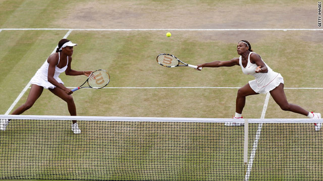 Venus and Serena Williams lost in the Wimbledon doubles to Russian pair Elena Vesnina and Vera Zvonareva.