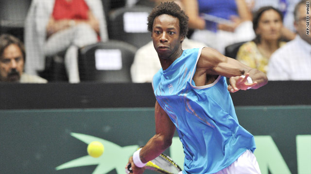 Gael Monfils withstood David Ferrer's brave fightback to set France on their way to a 2-0 Davis Cup advantage.