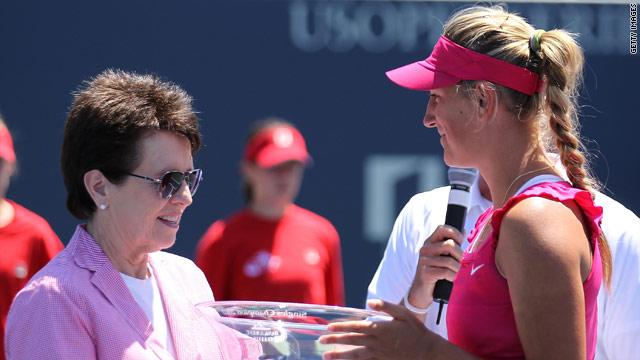 Azarenka receives her trophy from tennis legend Billie Jean King.