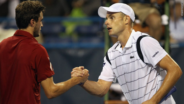 A shell-shocked Andy Roddick, right, shakes hands with Gilles Simon after losing to the Frenchman in Washington.