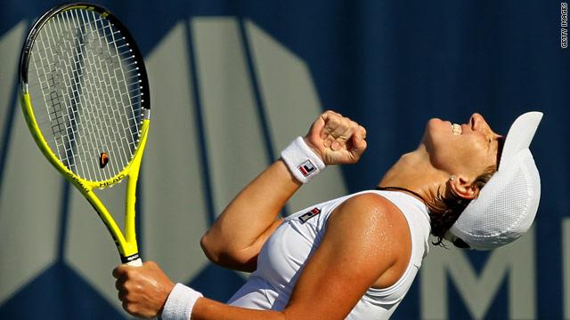 Svetlana Kuznetsova reacts with joy after beating Agnieszka Radwanska to secure the Mercury Open Insurance title.