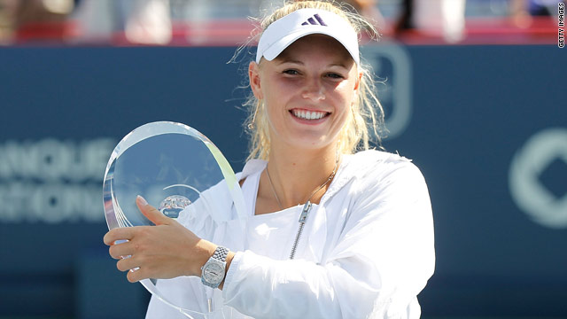 Caroline Wozniacki holds the Rogers Cup after beating Vera Zvonareva 6-3 6-2 in Montreal.