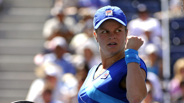 Clijsters signals victory in her first round match at Flushing Meadows against Greta Arn.