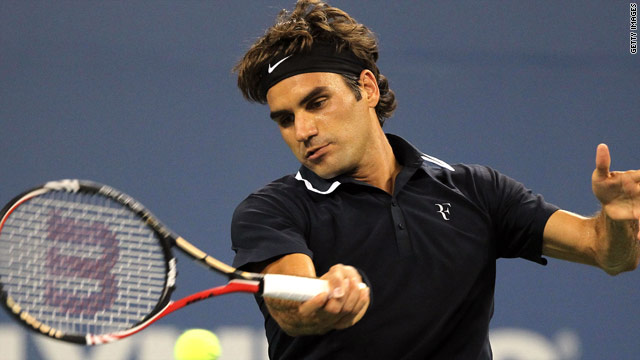 Top seed Roger Federer eased through to the second round in New York with a straight sets victory.