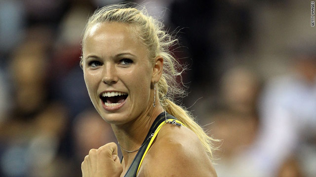 Caroline Wozniacki faces Russia's Vera Zvonareva in the semifinals of the U.S. Open after the Danish top seed put out Dominika Cibulkova in straight sets