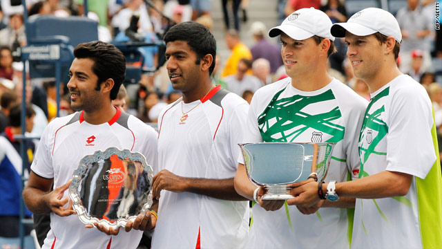 Aisam-Ul-Haq Qureshi and Rohan Bopanna (left) and Bob and Mike Bryan hold their trophies after the men's doubles final.