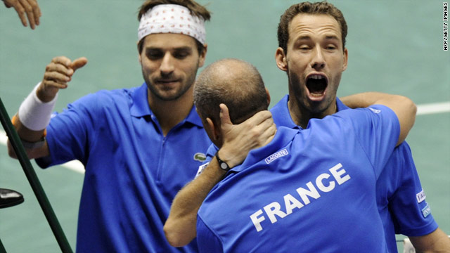 Michael Llodra and Arnaud Clement celebrate with team captain Guy Forget, after winning Davis Cup semi-final against Argentina.