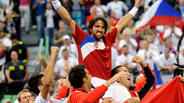 Janko Tipsarevic is hoisted about the heads of jubilant team members after taking Serbia into the Davis Cup final.