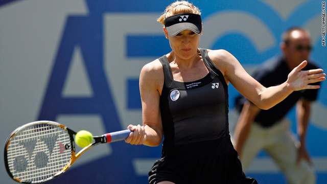 Elena Baltacha hits a shot against Samantha Stosur at the AEGON tennis tournament in Eastbourne, England, on June 17.